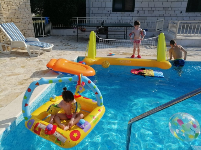 Kids playing on the swimming pool