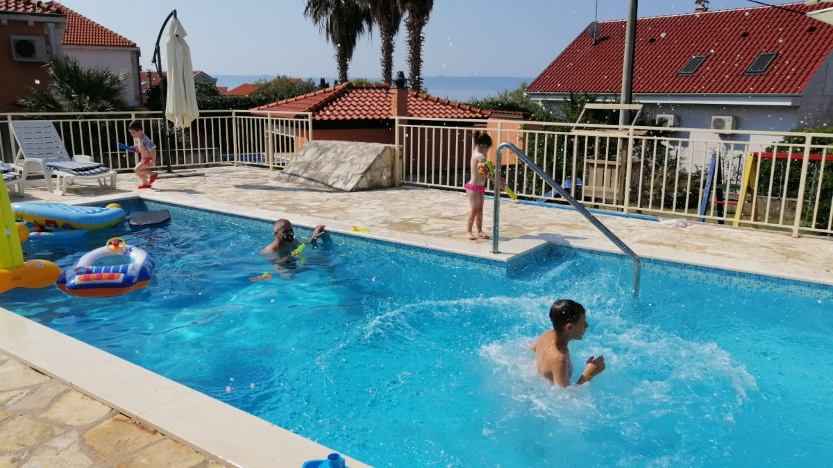 Kids having a fun time on the swimming pool of the Villa Vjeka