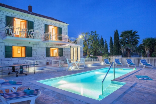 Illuminated Villa Vjeka with the private swimming pool, sunbeds and table tennis on the main terrace