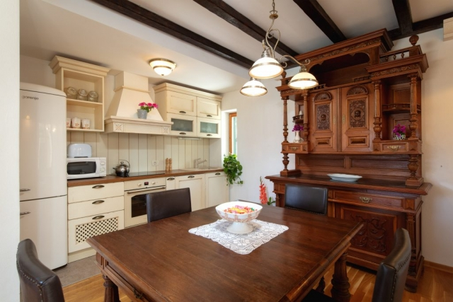 Traditional Dalmatian kitchen with the wooden elements and wooden ceiling beams in the Villa Vjeka